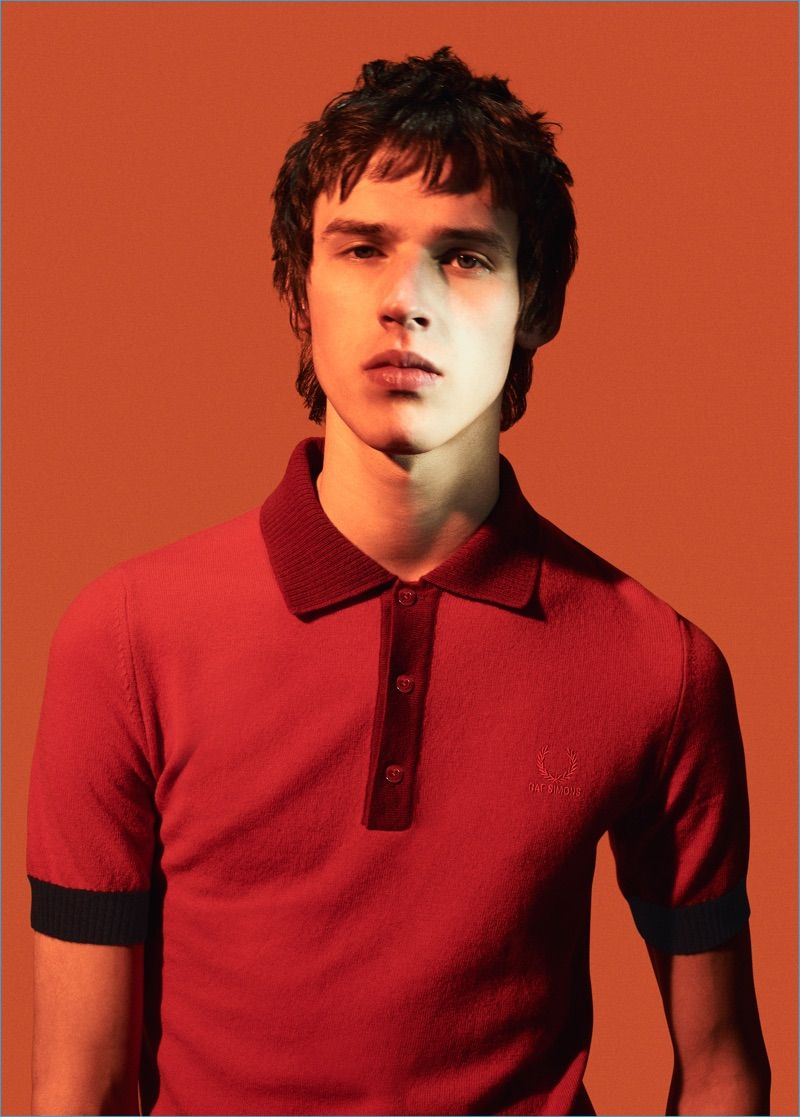 c0f8003bd0676 Raf Simons for Fred Perry turns out a red fitted polo shirt with a knit  collar for fall-winter 2016.