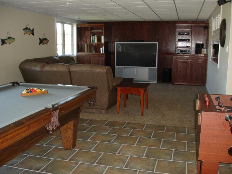 basement with pool table and lounge area
