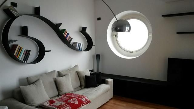 Bookworm kartell kartell bookworm shelf designed by ron arad with