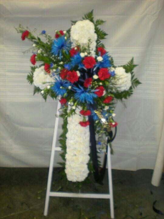 Cross Of White Carnations Base With Spray Of Red Carnations Blue Mums White Mini Carnations Funeral Flower Arrangements Funeral Flowers Sympathy Flowers