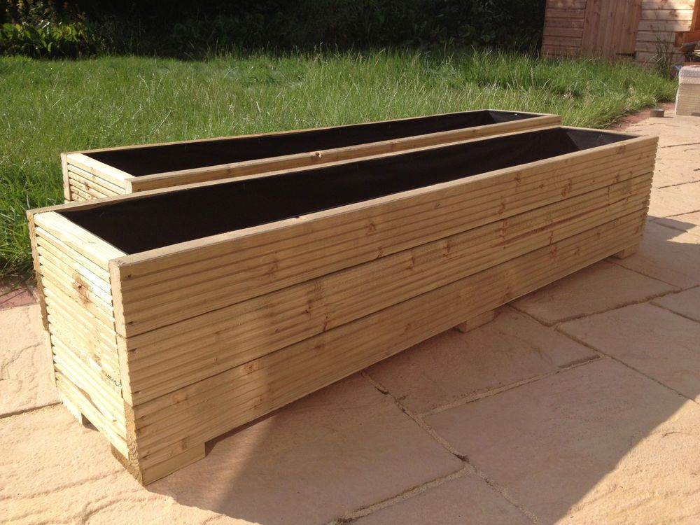 large wooden garden planter trough in decking boards free lining