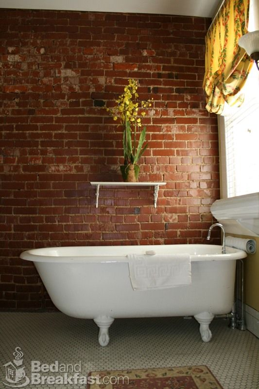 not only do i love those tubs but i love exposed brick. it adds so