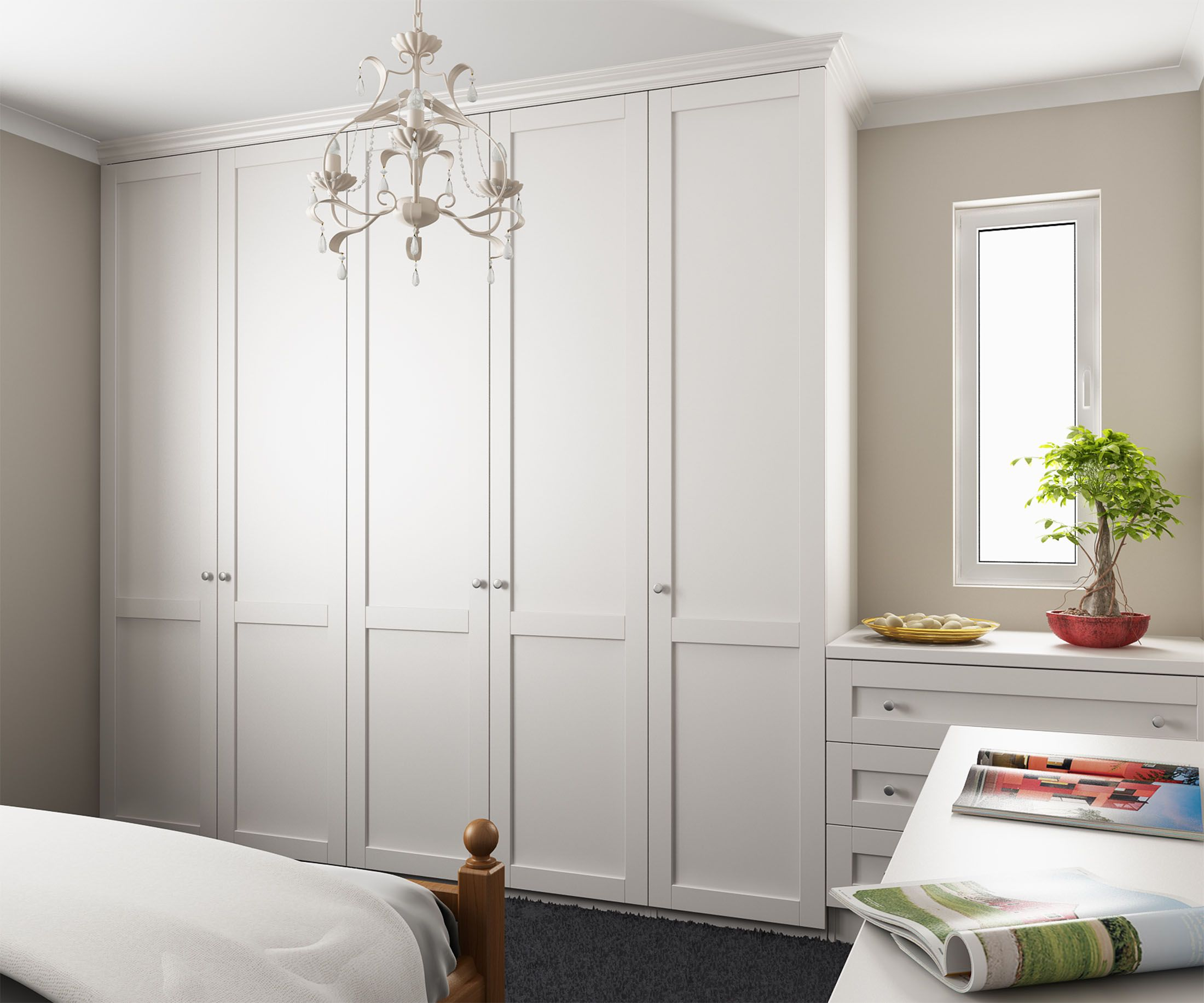 Tall wardrobes along left wall, dressing table/drawers with mirror ...