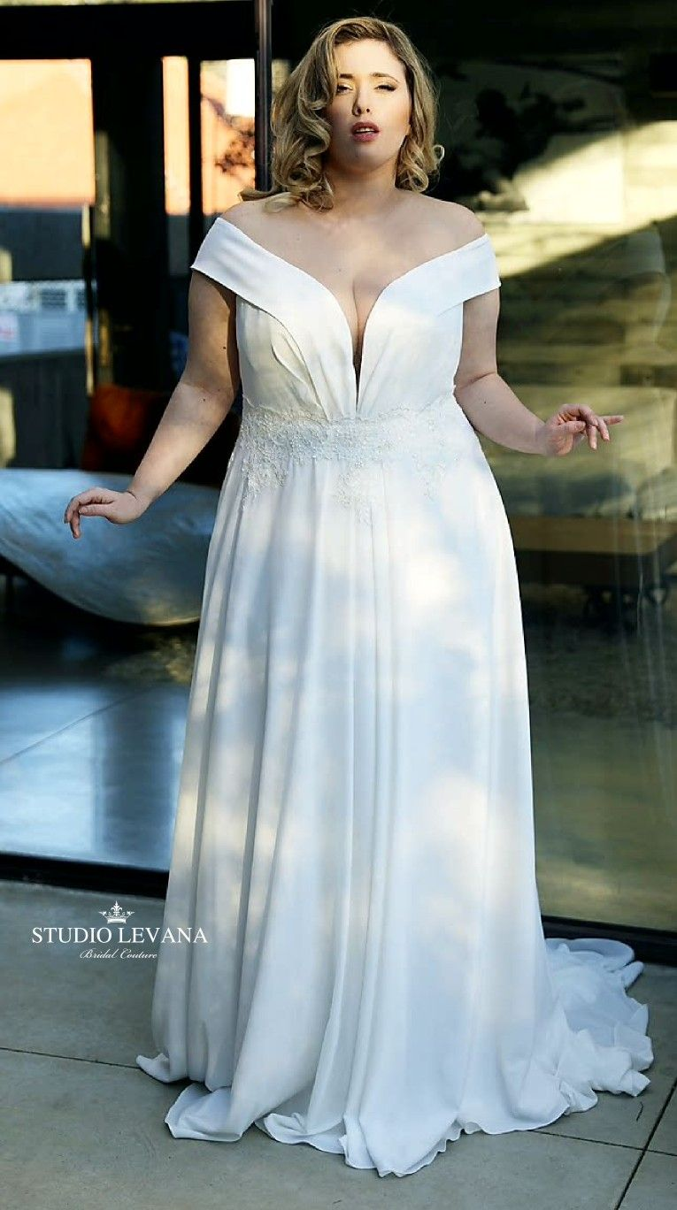 Light Plain Crepe Plus Size Wedding Dress With Off Shoulder Straps And Flowy Skirt Saar Plus Size Wedding Gowns Wedding Dresses With Straps Wedding Dresses [ 1368 x 765 Pixel ]