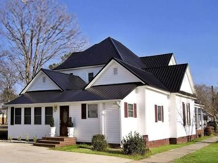 White Brick Home With Dark Roof Google Search Metal Roof Houses Residential Metal Roofing White Brick Houses