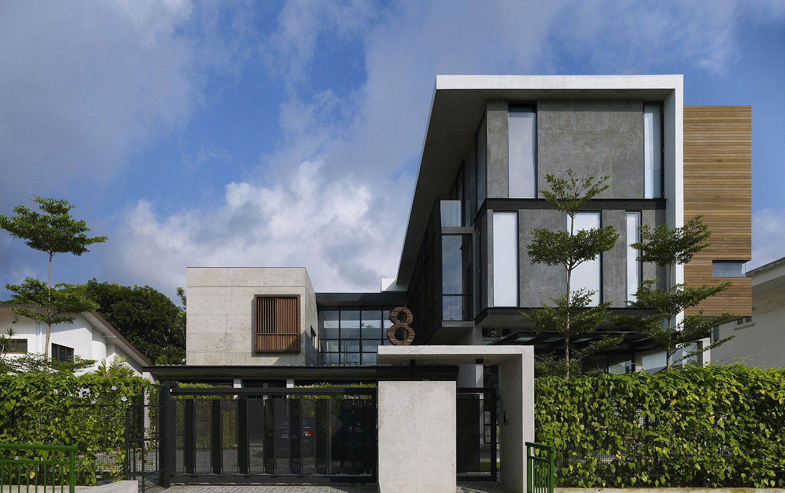 Elegantly imposing, this contemporary home employs the traditional ...