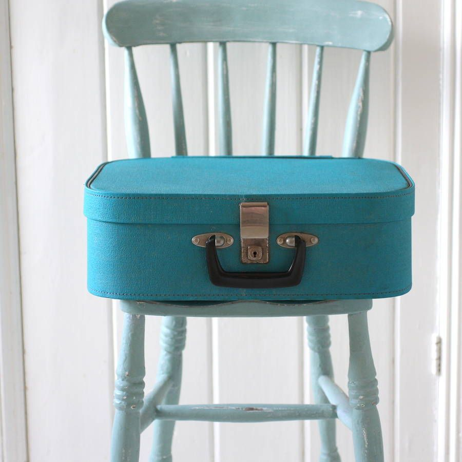ONE AVAILABLE Pack up your troubles, or your keepsakes, or your piles of paperwork, or your best shoes in this fabulous little vintage suitcase.A beautiful, striking shade of turquoise blue, it's compact size means it can be used in just about any room. It would make a great gift for a travel lover, or just someone who could do with a little bit of extra storage to keep their house in order. There are some signs of wear but in our opinion this still makes fantastic vintage storage! .<em>At…