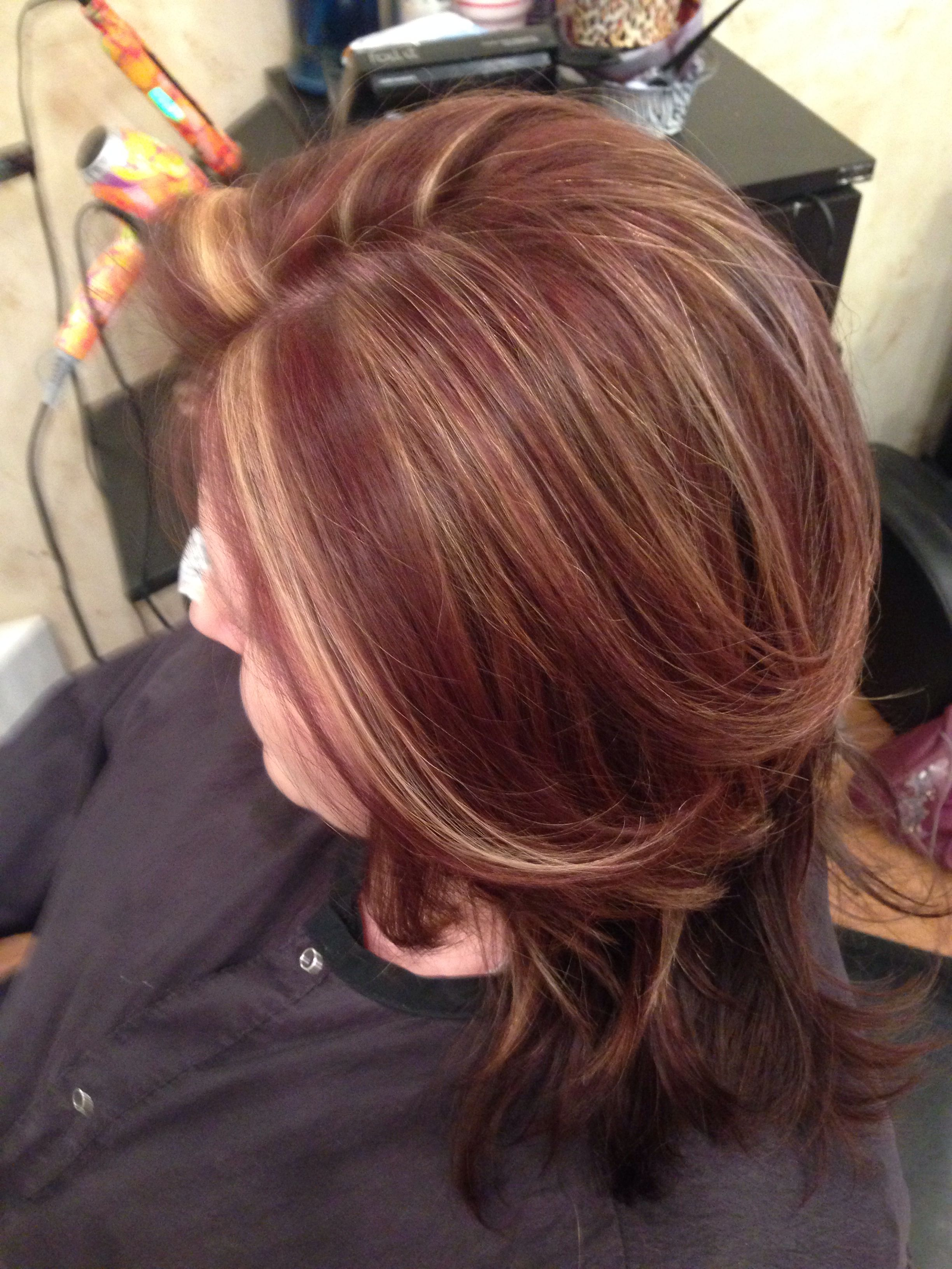 Warm blonde chunks with racing red and chocolate brown lowlights