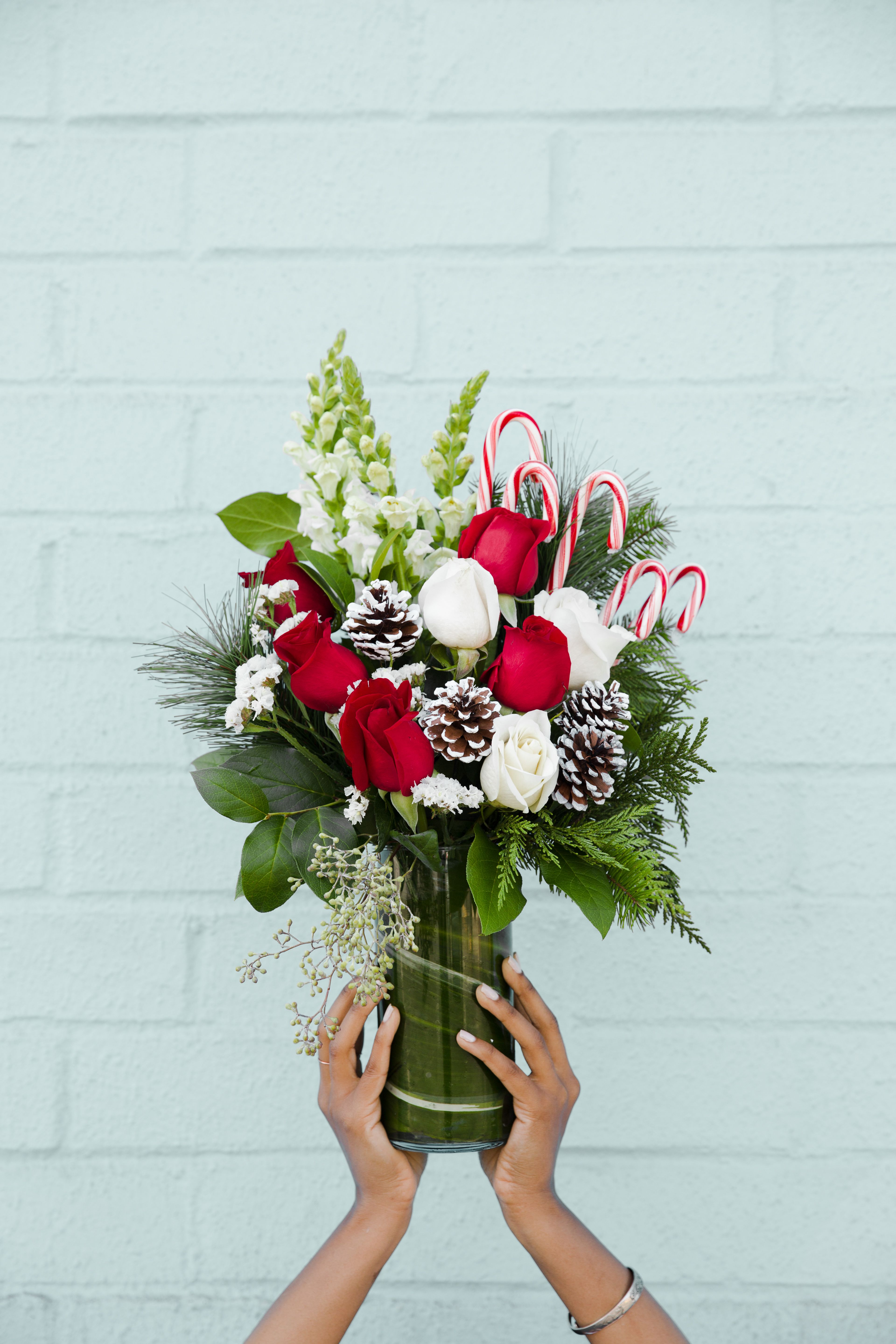 Love the candy canes!!!! Christmas Flower Bouquet with Candy Canes ...