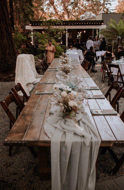 Boho wedding reception decor idea - long, wooden tables ...