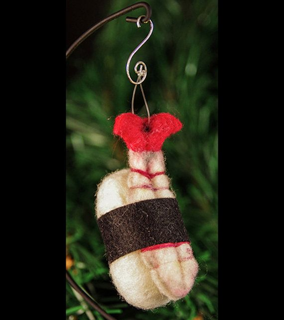 Sushi shrimp ornament: Felted Chicken's humor shines in her work! If you are a Day of the Dead fan, you will also need to check out her pulp skulls. Sushi lovers can pick other prepared felt foods, too.