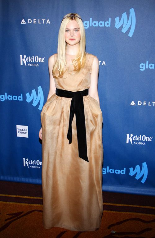 Elle Fanning attends the 2013 GLAAD Media Awards in Los Angeles, California in a Lanvin gown accessorized with a Jennifer Behr headwrap and Neil Lane jewelry.