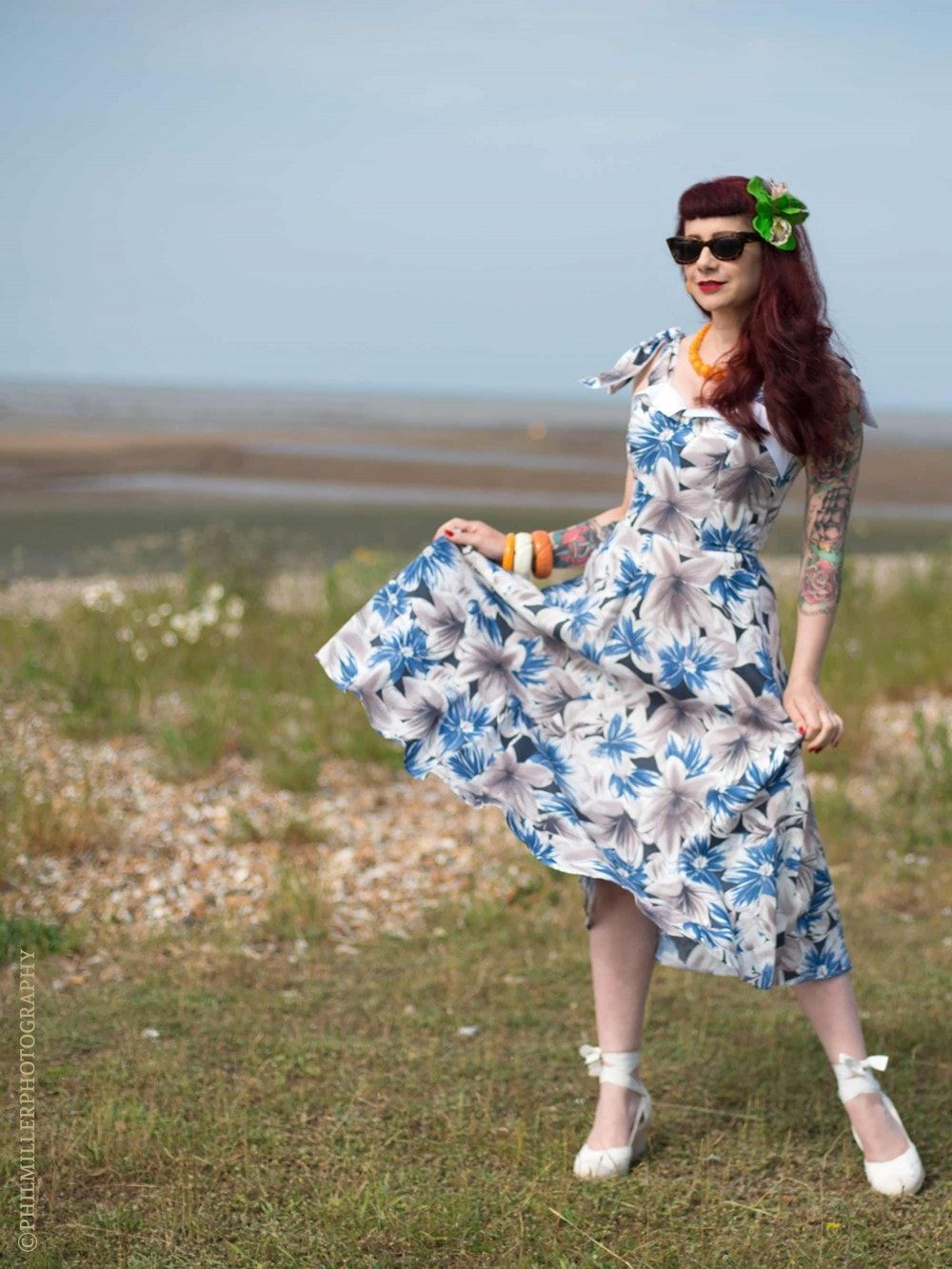 This beautiful floral print comes in some of your favourite VOH styles, like the gorgeous Sarong Set or charming Runaround Sue! 😍 Be ready for the warm season in pretty blue tones! Which is your favourite style?  #vivienofholloway@vivienofholloway  @katiepedlow @annafurlaxis @remixvintageshoes  #madeinlondon #vintagestyle #vintagefashion #retro #pinupgirl #pinupstyle  #slowfashion  #sarongdress #tikiparty  #hawaiiandress #50sdress #tikistyle #daydress #1940sdress #runaroundsue