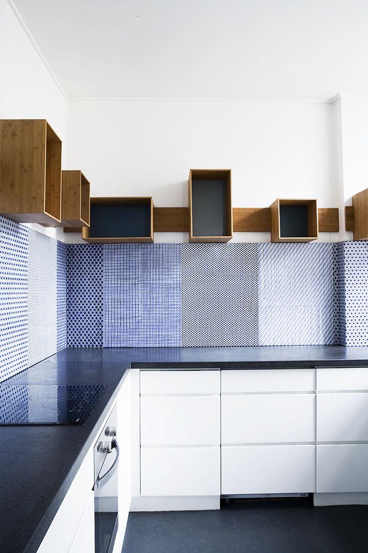 Large Panels Of Intricate Blue Tiles As A Blacksplash In Modern Kitchen Image