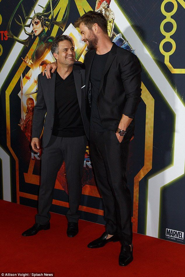 be1a6de888ad Well-dressed: Mark looked dapper in a black V-neck T-shirt, teamed with a  charcoal suit ja.