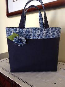 Photo of Os tecidos e as flores kanzashi