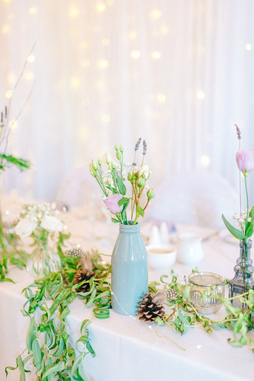 Vases with Wild Flower Stems Table Decor - Sarah-Jane Ethan Photography | Military Wedding at Hoyle Court in London | Essense of Australia Wedding Dress | Slaters Suits | Wild Flowers | Rustic Decor