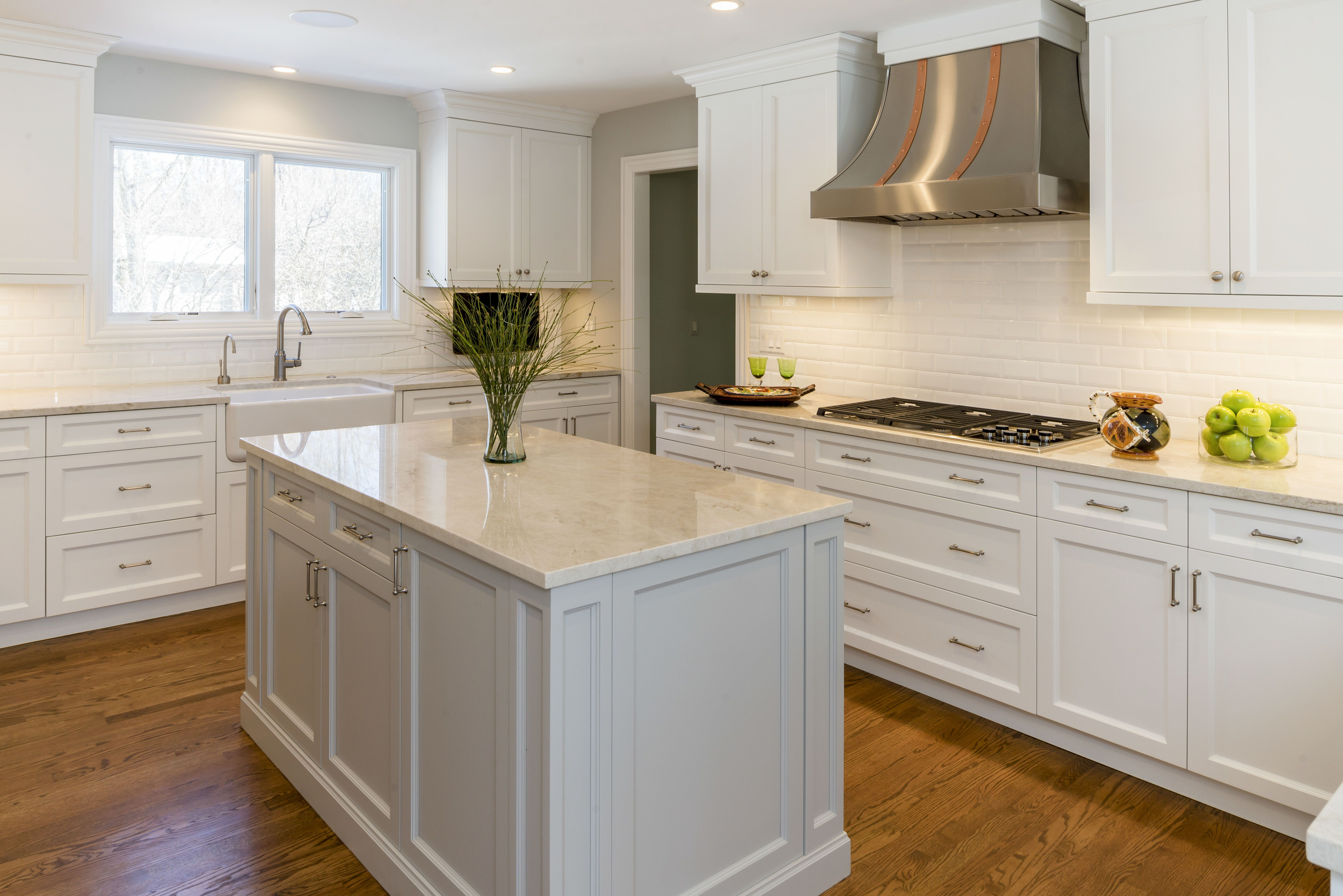 White kitchen. Granite Countertops. Stainless Steel Stove Hood. Subway tile back splash. Hardwood Floors. Kitchen design. Kitchen ideas. Kitchen remodel.