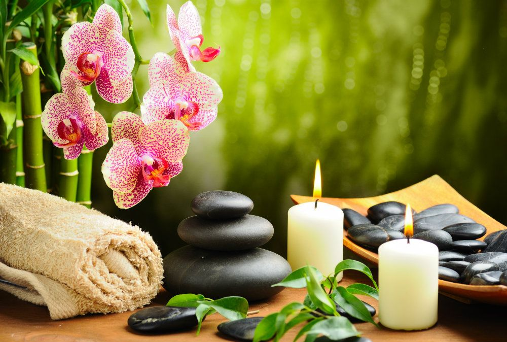 towels candles stones exotic flowers spa experience stress