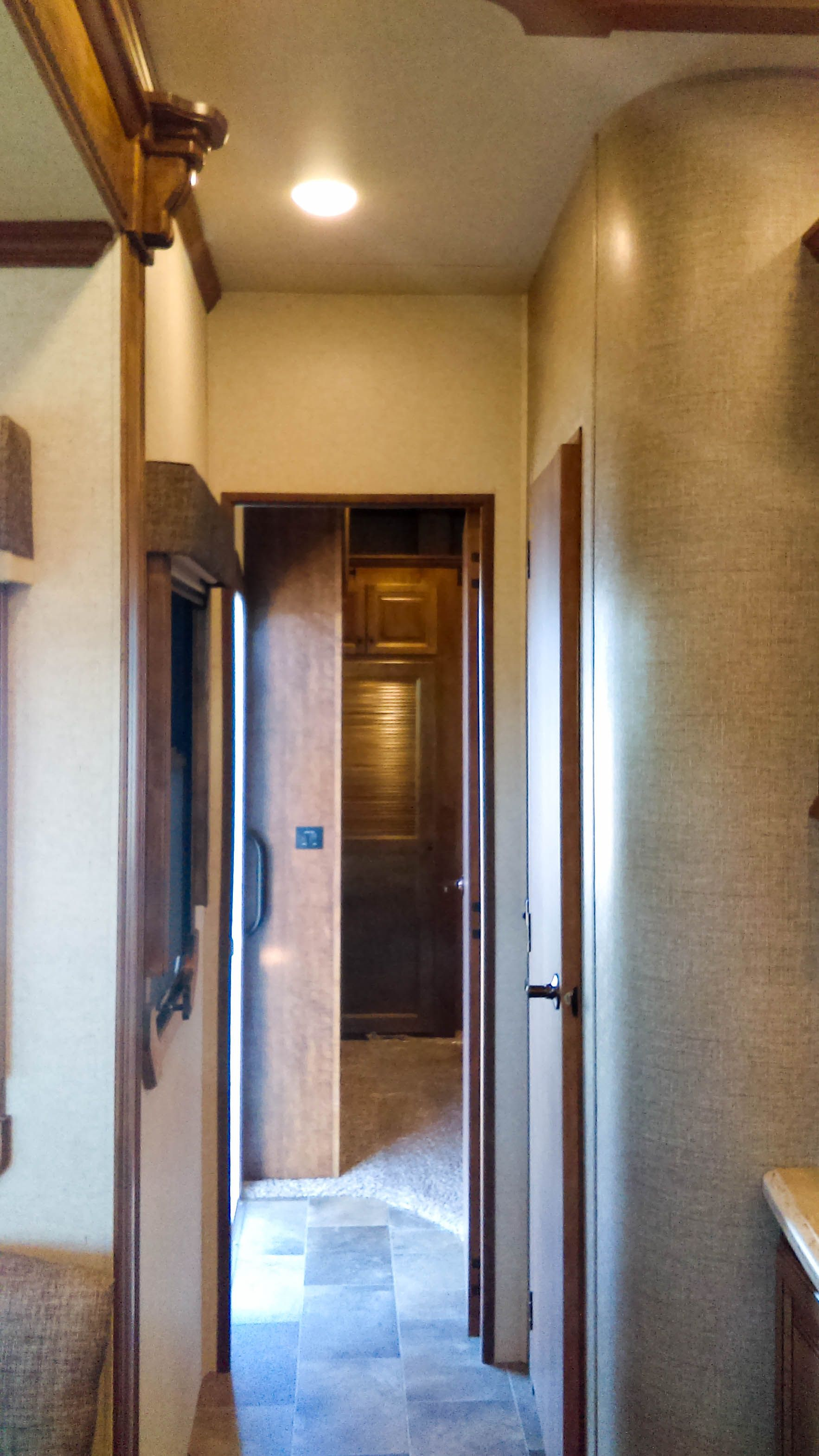With its incredible ceiling height and beautiful cabinetry, the 2016 Landmark Madison feels upscale yet cozy like home. #MyHeartland #Landmark Gallery: http://www.heartlandrvs.com/classes/luxuryfw/lm365-landmark