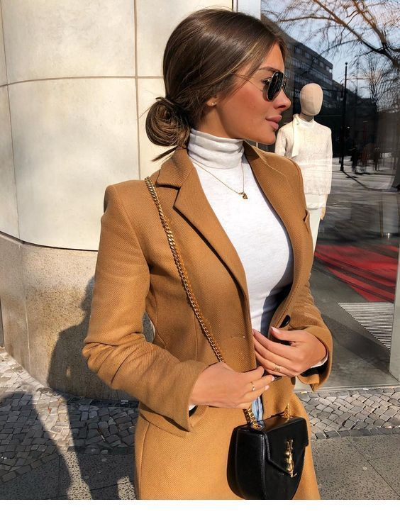 blouse and brown coat White blouse and brown coat