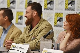 Actors Marton Csokas (C) and Emily Beecham speak onstage at AMC's 'Into the Badlands' at Comic-Con 2015 on July 11, 2015 in San Diego, California.