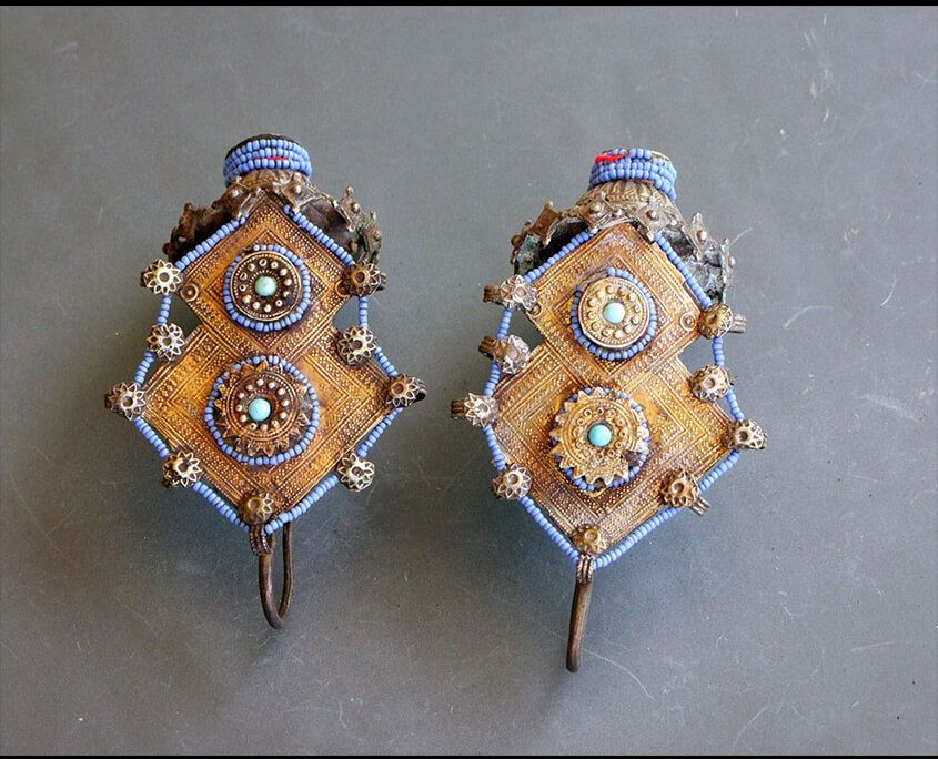 Gilded Ear Ornaments from the Katawaz Peoples.  Gilded Silver and blue glass ear pendants; they originate from the Islamic people of the Katawaz basin along the border of Afghanistan/Pakistan  Length about 13,5cm  Silver (part of it gilded), Glassbeads  19th century