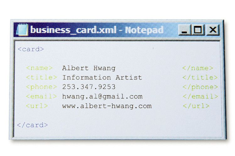 Mr. Hwang draws attention to his tech prowess with a card printed to look like...
