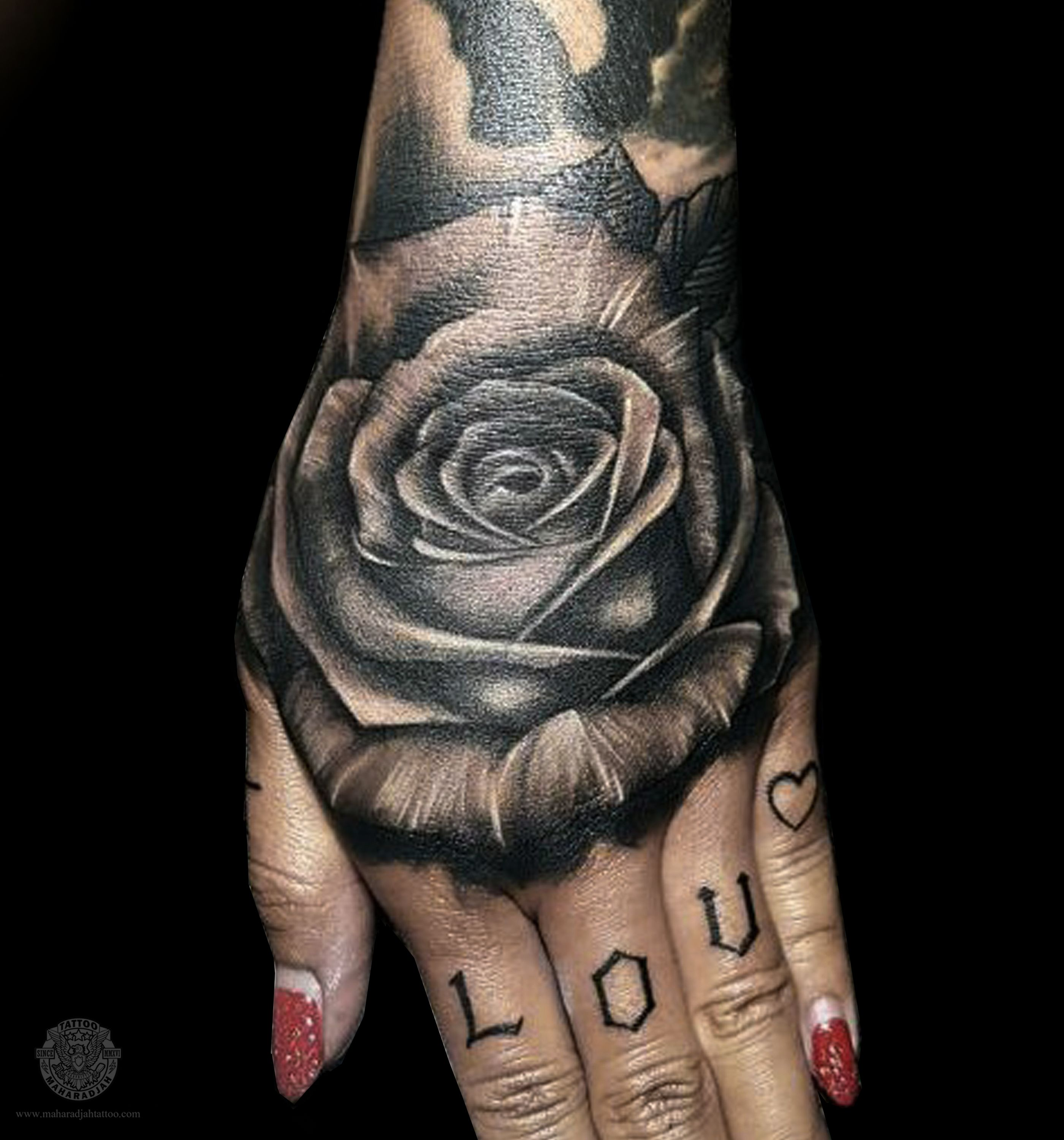 Beautiful rose tattoo design done by oneof our artist at