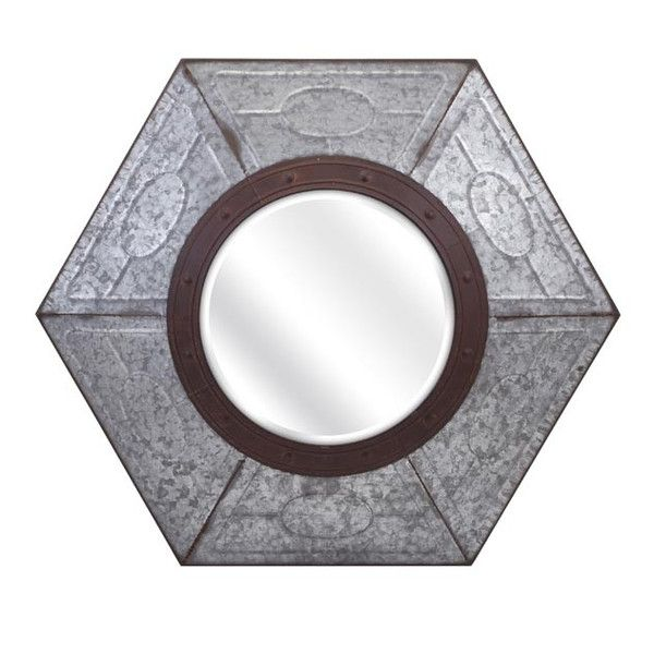 This galvanized metal wall mirror features a center porthole ...