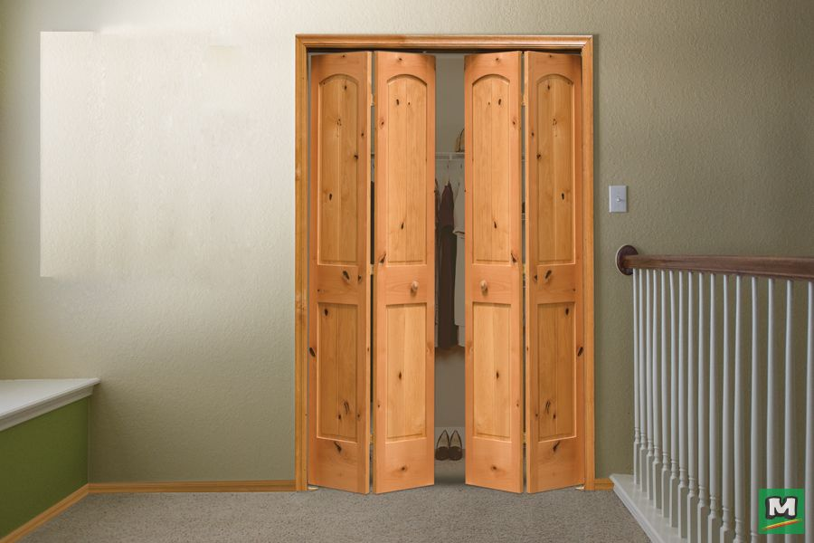 Conceal A Closet In Style With This Mastercraft 24 X 80 Knotty Alder Bifold Door An Arched Raised Panel Plank Design These Doors Can Be Stained
