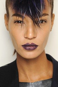 MFW: Matte skin, defined brows and make-up-free eyes allowed the lips to be the focus (Joan Smalls at Fendi).