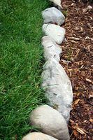 Lawn Edging Ideas to Keep Grass Out is part of lawn Edging Rocks - Lawn Edging Ideas to Keep Grass Out  Sometimes one of the most frustrating things about planting a flower or vegetable garden in your yard can be keeping grass out of the garden  Using lawn edging helps gardeners further separate their lawns from the garden space  Edging also helps create a physical border between garden soil and the lawn, keeping
