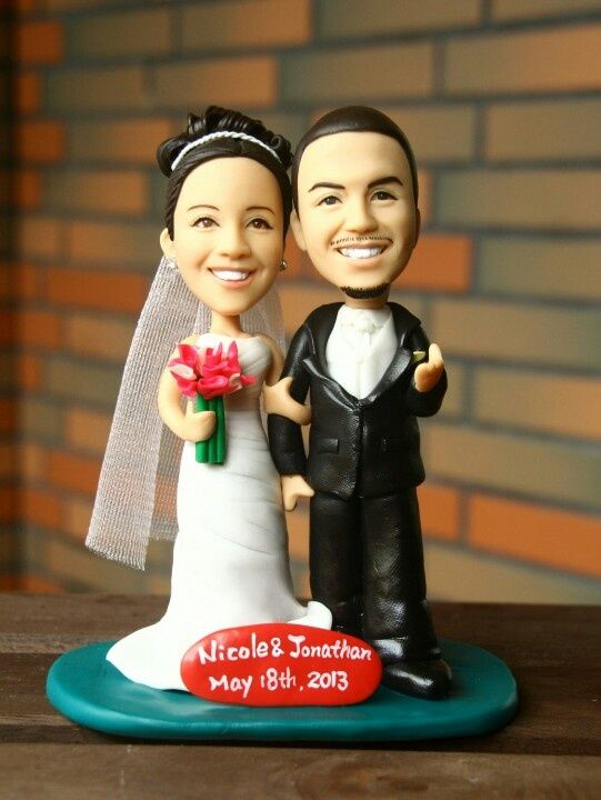 Interracial bobble head wedding toppers