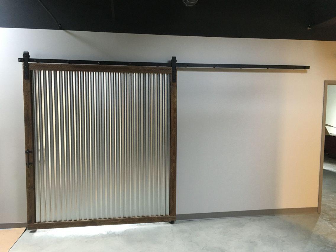 Corrugated Metal Sliding Barn Door With Rough Sawn Frame Garage Door Styles Sliding Garage Doors Barn Door