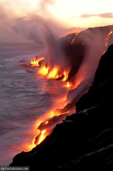 Active lava flows touching the ocean, Hawaii -...
