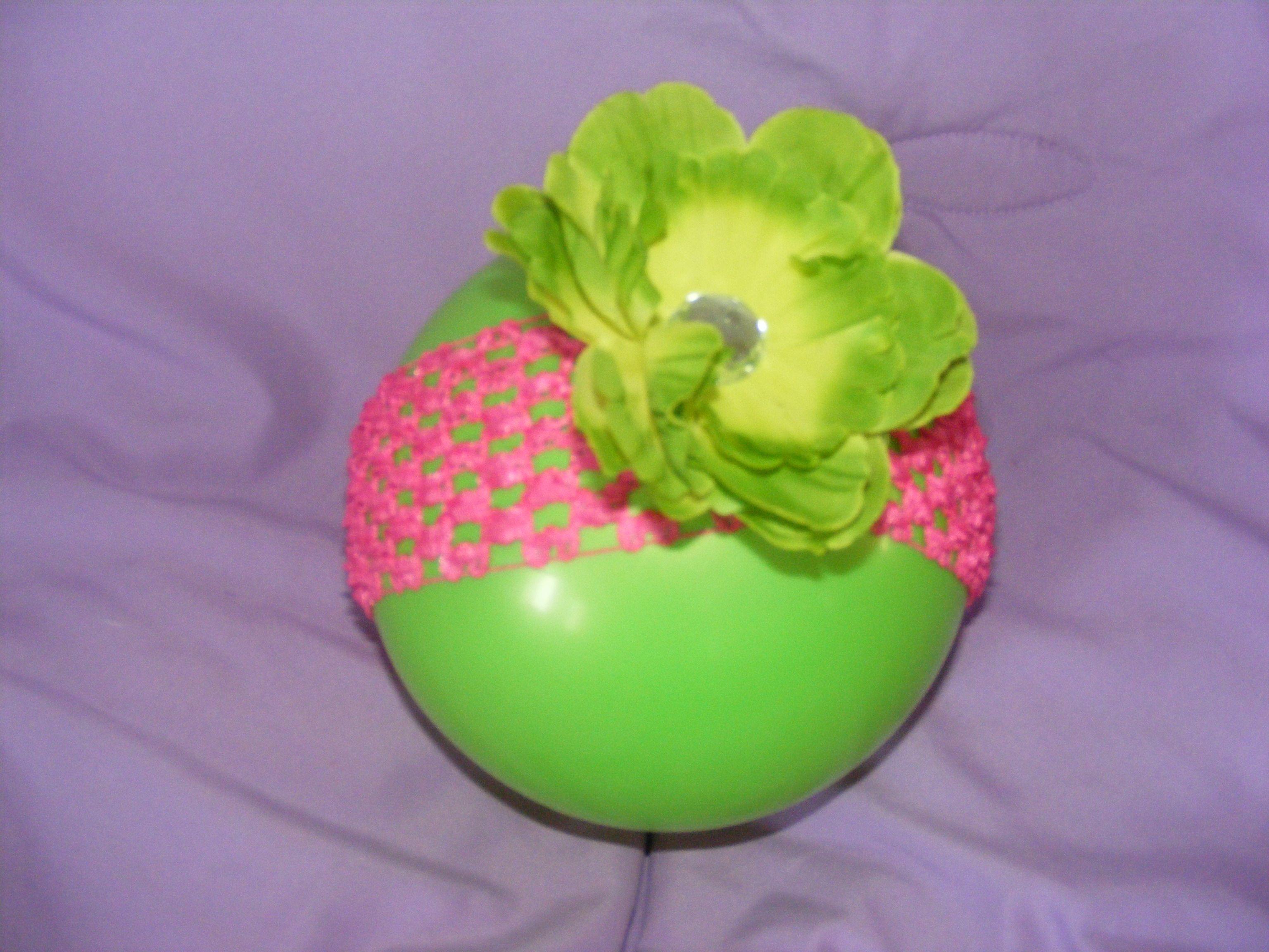 pink crochet headband, green flower