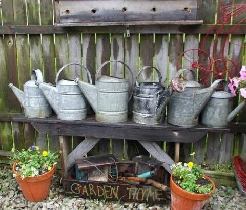 Collection of old watering cans