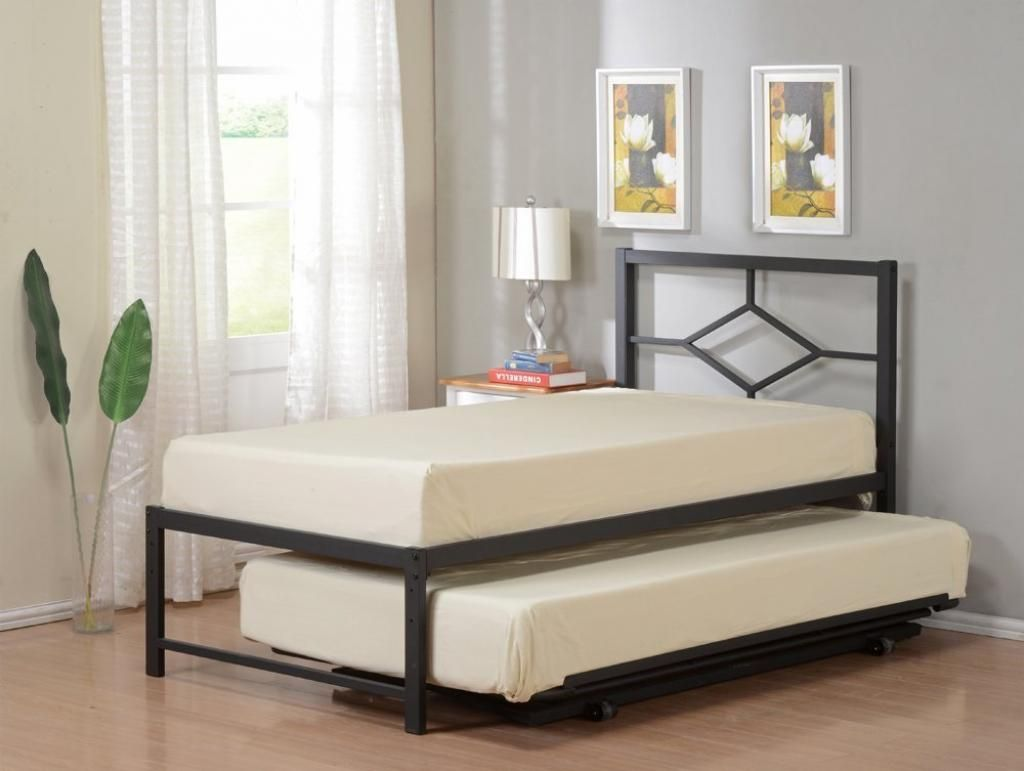 Small Beige Bed Trundle Design Beside Glass Window And Gray Paint