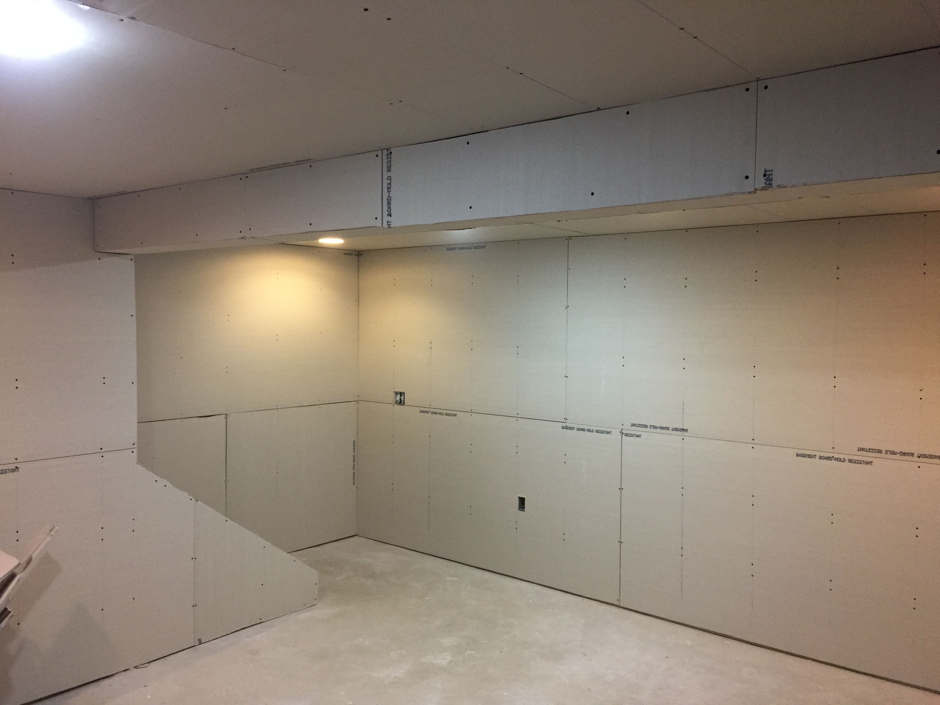 How To Finish A Basement On A Budget Revival Woodworks Basement Makeover Diy Basement Waterproofing Basement