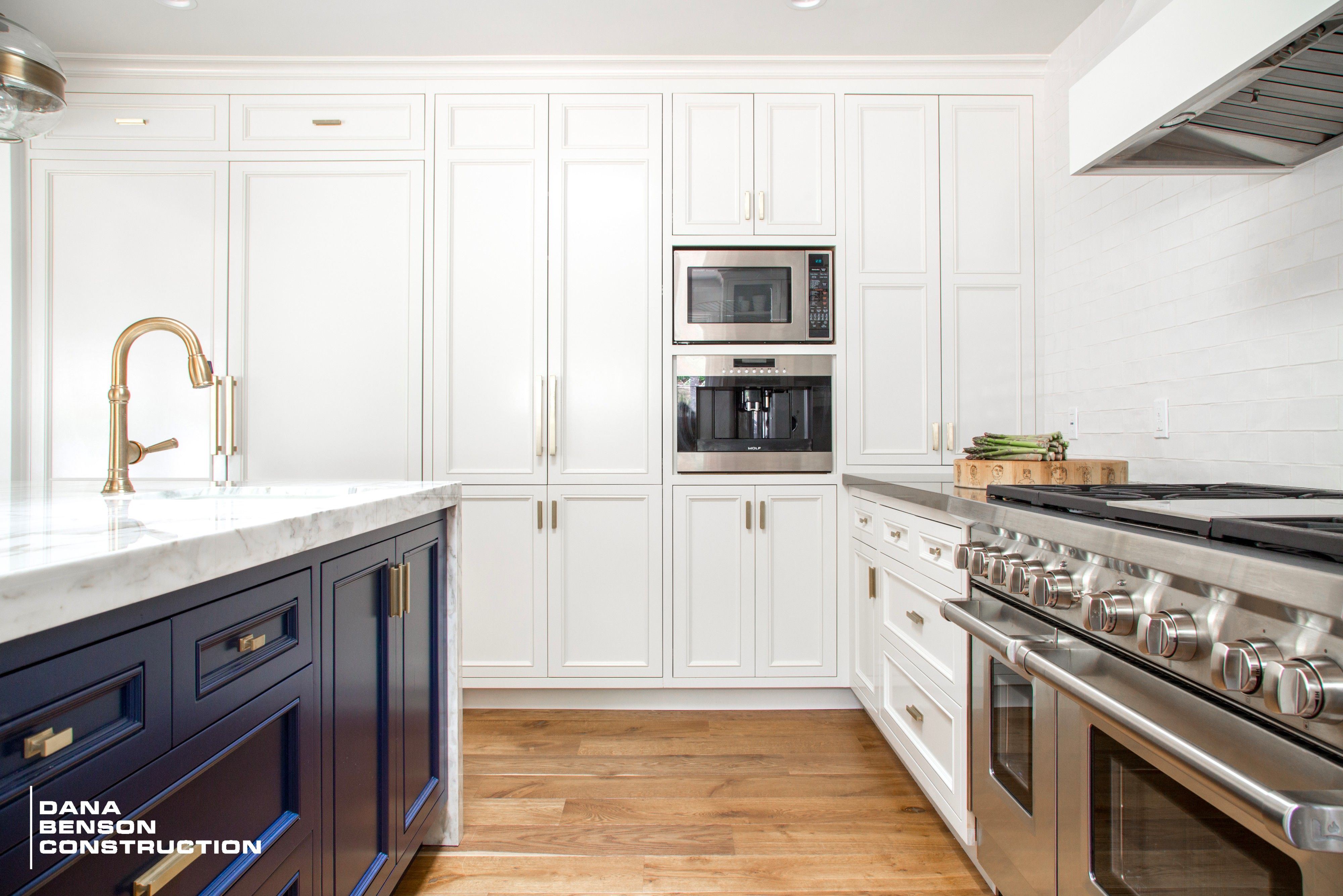 Spanish Transitional To Modern Style Kitchen With Black And White Cabinets  And Gold Finishes Design And Build By Dana Benson Construction