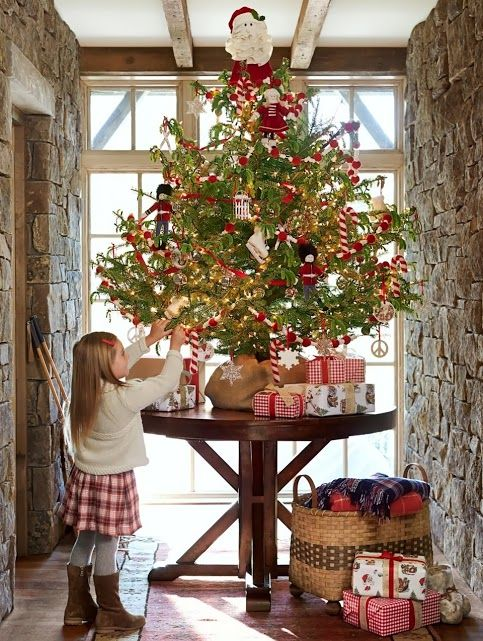 Tiny Christmas tree on a table w. burlap base. This could work ...