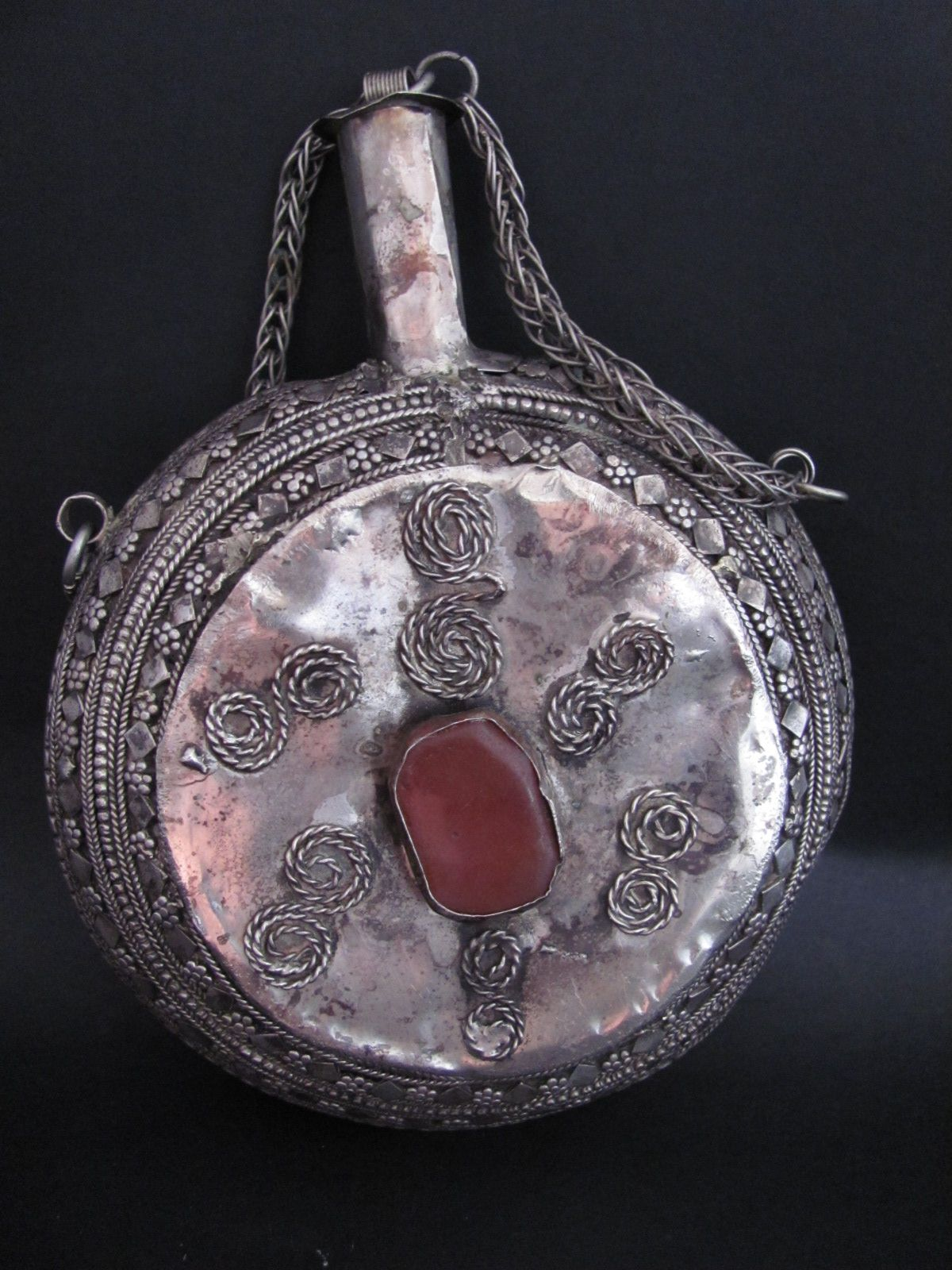 Antique Yemeni Bedouin Khol Container from East Yemen.  Made of old mixed metals and decorated with agates.  This kind of khol bottles were mostly used by men on their belts, at the side of tobacco boxes, coin holders, and the classic Yemeni Djambia. The khol is used by all yemeni population, men, women and children as a way to protect the eyes from infections and also as a natural cosmetic.