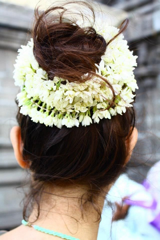 Modern Indian Hairstyles Top knot and jasmine flowers ...