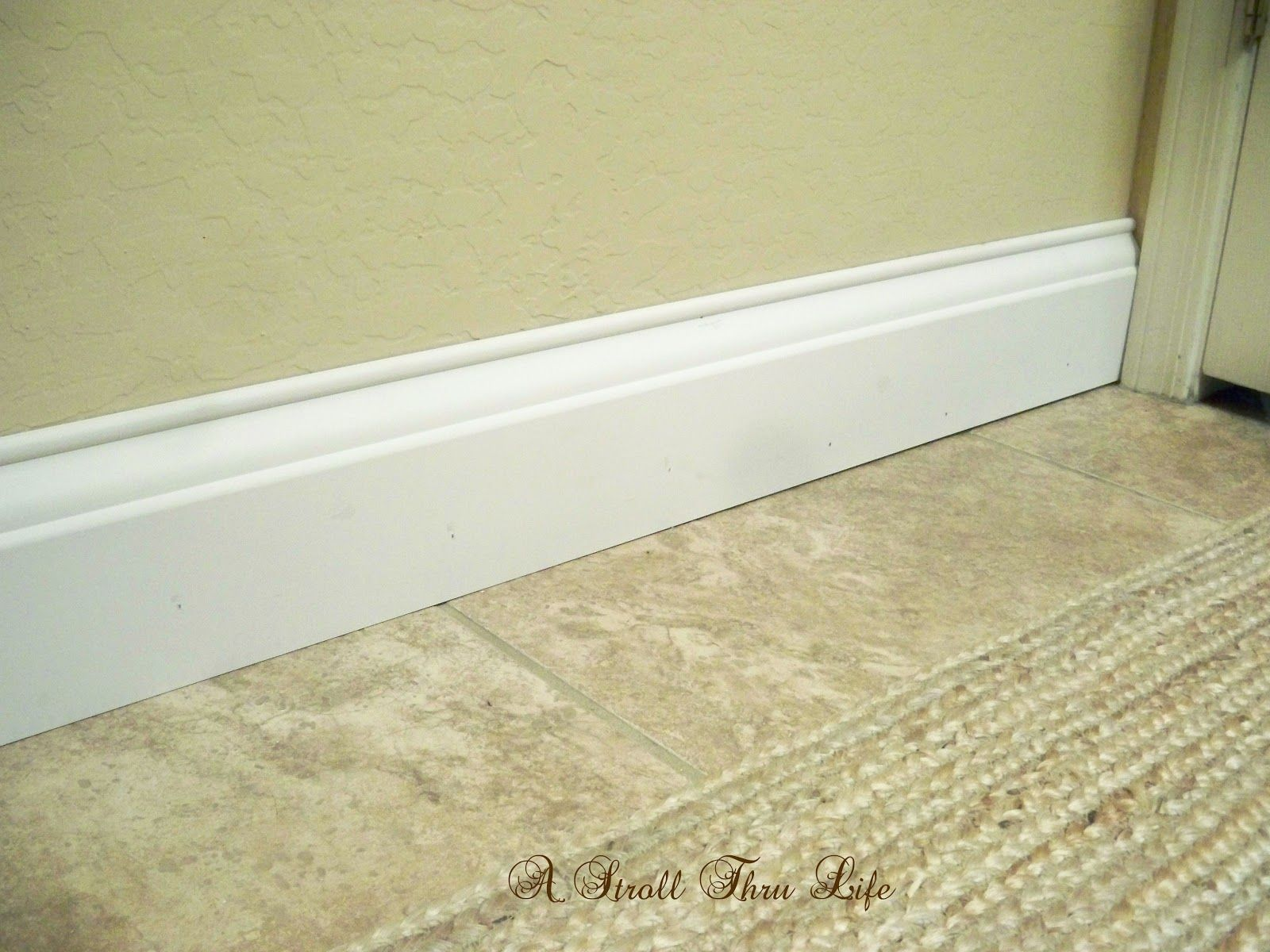 Install Wide Baseboard Molding Over Existing Narrow Baseboard A Stroll Thru Life Baseboard Molding Bathroom Baseboard Baseboard Trim