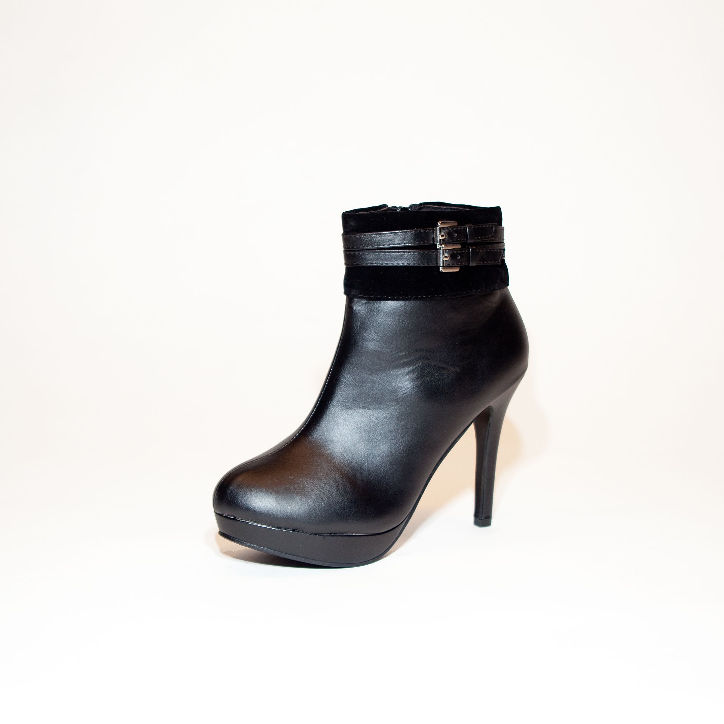 "Almyra!  Step out in this sassy stiletto heeled ankle #boot for a look that will turn heads! This  platform bootie has a sleek silhouette and decorative ankle straps that will dress up any day to night look.  Find ""Almyra"" at www.steam-boots.ca"