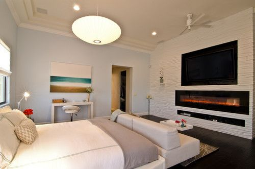 Glorious Light Grey Themed Bedroom Ideas For Couples Furnished With White Bed Sofa And Tv And Fireplace Bedroom Fireplace Luxurious Bedrooms Bedroom Design