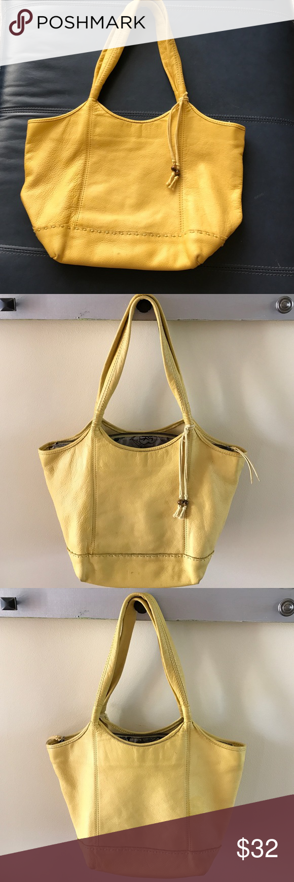Leather purse, The Sak brand, yellow Soft leather!  Loved the size of this purse!  One main compartment with a zip closure.  It is previously loved and does show discoloration because someone spilled something on it during a night out.   It is not perfect, but makes a great shoulder bag for casual use----like the kind you don't mind putting in a grocery cart cuz it may get dirty, if ya know what I mean!  My price reflects the imperfections. The Sak Bags Shoulder Bags