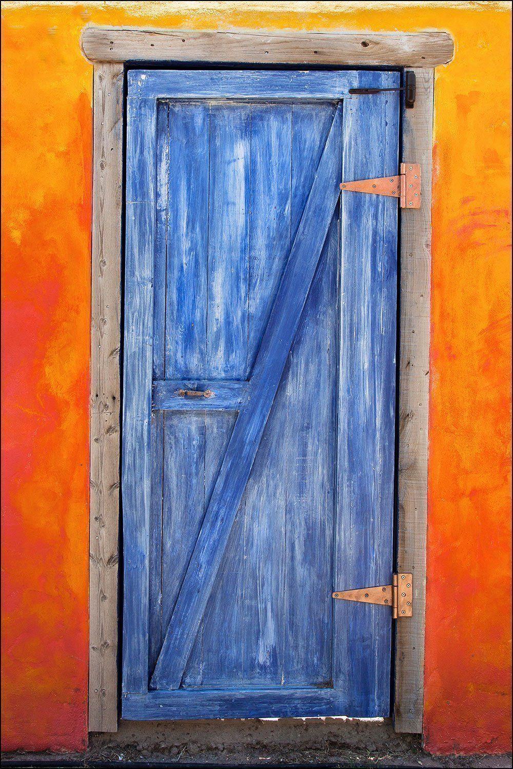 Photograph of very colorful american southwest blue wood barn door