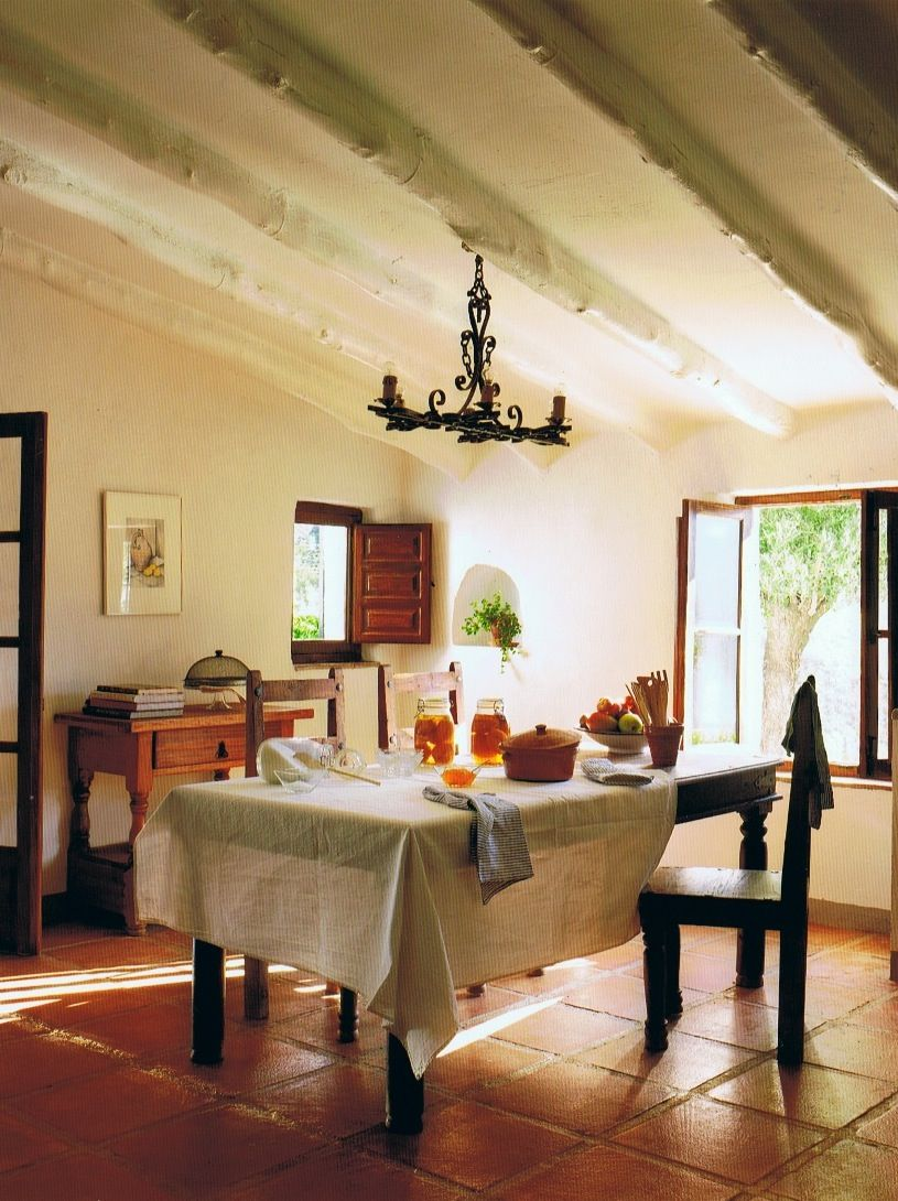 The Olive Grove  ::   Malaga, Spain  :: Painted wooden tree trunk beams run hte lenth of the ceiling in the dining room.